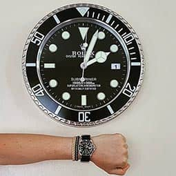 Rolex Submariner Date 116610LN with Rolex Submariner Dealer Wall Clock